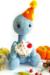 Happy Monroe Dinosaur Amigurumi Crochet Pattern with cupcake